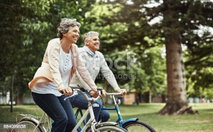 Cropped shot of a mature couple enjoying a bike ride in the park
